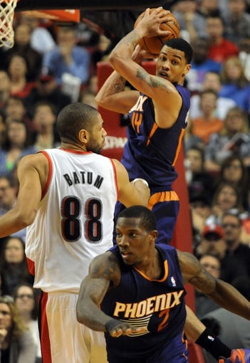 Apr 4, 2014; Portland, OR, USA; Phoenix Suns guard Gerald Green (14) grabs the ball after Phoenix Suns guard Eric Bledsoe (2) blocked the shot of Portland Trail Blazers forward Nicolas Batum (88) from behind during the fourth quarter of the game against the Phoenix Suns at Moda Center. the Suns won the game 109-93. Mandatory Credit: Steve Dykes-USA TODAY Sports