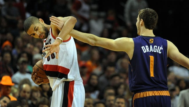 Apr 4, 2014; Portland, OR, USA; Phoenix Suns guard Goran Dragic (1) gets tangled up with Portland Trail Blazers forward Nicolas Batum (88) during the fourth quarter of the game at Moda Center. The Suns won the game 109-93. Mandatory Credit: Steve Dykes-USA TODAY Sports
