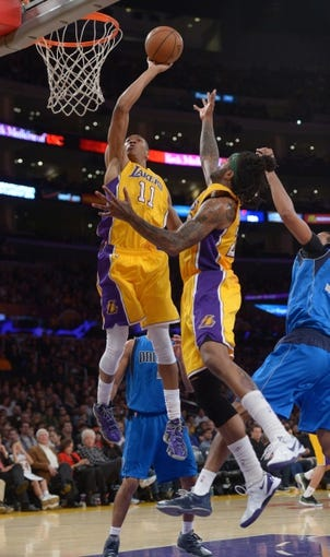 Apr 4, 2014; Los Angeles, CA, USA; Los Angeles Lakers forwards Wesley Johnson (11) and Jordan Hill (27) battle for the ball against the Dallas Mavericks at Staples Center. The Mavericks defeated the Lakers 107-95.  Mandatory Credit: Kirby Lee-USA TODAY Sports