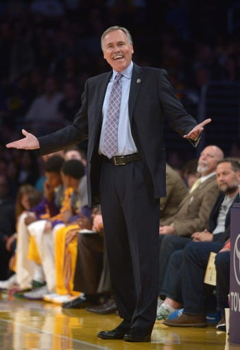 Apr 4, 2014; Los Angeles, CA, USA; Los Angeles Lakers coach Mike D'Antoni reacts during the game against the Dallas Mavericks at Staples Center. Mandatory Credit: Kirby Lee-USA TODAY Sports