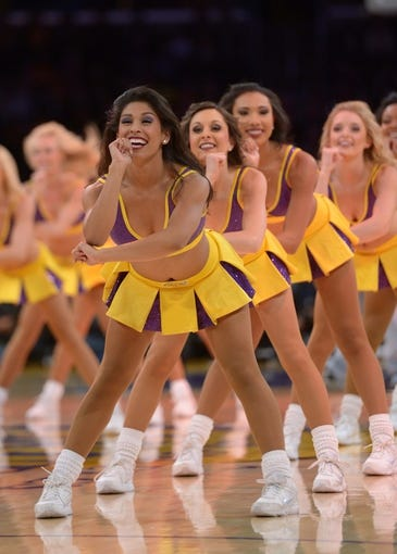 Apr 4, 2014; Los Angeles, CA, USA; Los Angeles Laker girls cheerleaders perform during the game against the Dallas Mavericks at Staples Center. Mandatory Credit: Kirby Lee-USA TODAY Sports