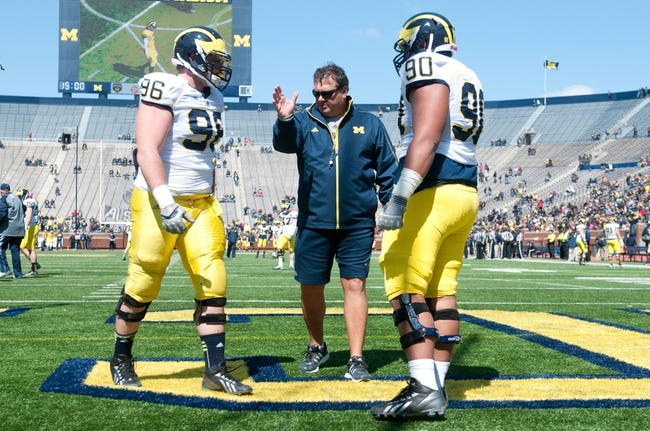 Apr 5, 2014; Ann Arbor, MI, USA; Michigan Wolverines head coach Brady Hoke coaches defensive lineman Ryan Glasgow (96) and defensive tackle Bryan Mone (90) during the Spring Game at Michigan Stadium. Mandatory Credit: Tim Fuller-USA TODAY Sports