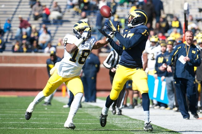 Apr 5, 2014; Ann Arbor, MI, USA; Michigan Wolverines wide receiver Freddy Canteen (17) and defensive back Blake Countess (18) during the Spring Game at Michigan Stadium. Mandatory Credit: Tim Fuller-USA TODAY Sports