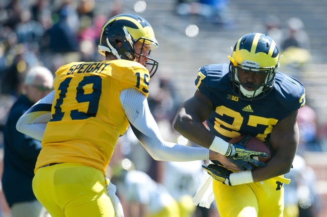 Apr 5, 2014; Ann Arbor, MI, USA; Michigan Wolverines quarterback Wilton Speight (19) hands the ball off to running back Derrick Green (27) prior to the Spring Game at Michigan Stadium. Mandatory Credit: Tim Fuller-USA TODAY Sports