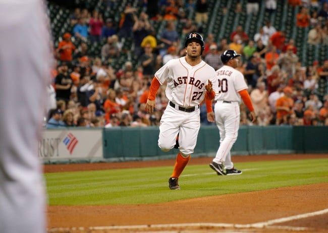 Apr 5, 2014; Houston, TX, USA; Houston Astros second baseman Jose Altuve (27) scores a run during the first inning at Minute Maid Park. Mandatory Credit: Andrew Richardson-USA TODAY Sports