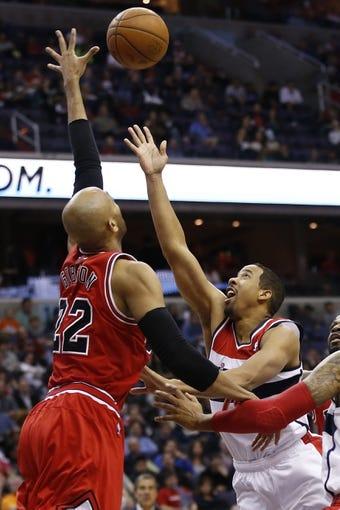 Apr 5, 2014; Washington, DC, USA; Chicago Bulls forward Taj Gibson (22) blocks the shot of Washington Wizards guard Andre Miller (24) in the second quarter at Verizon Center. Mandatory Credit: Geoff Burke-USA TODAY Sports