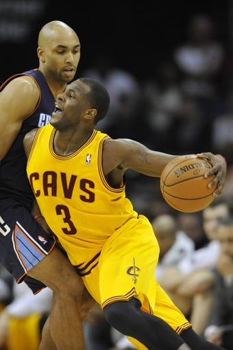 Apr 5, 2014; Cleveland, OH, USA; Cleveland Cavaliers guard Dion Waiters (3) drives against Charlotte Bobcats guard Gerald Henderson (9) in the second quarter at Quicken Loans Arena. Mandatory Credit: David Richard-USA TODAY Sports