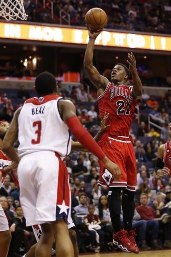 Apr 5, 2014; Washington, DC, USA; Chicago Bulls guard Jimmy Butler (21) shoots the ball over Washington Wizards guard Bradley Beal (3) in the fourth quarter at Verizon Center. The Bulls won 96-78. Mandatory Credit: Geoff Burke-USA TODAY Sports