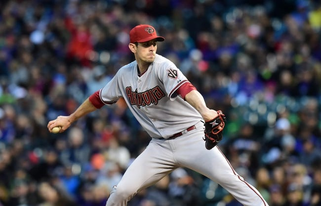 Apr 5, 2014; Denver, CO, USA; Arizona Diamondbacks starting pitcher Brandon McCarthy (32) pitches against the Colorado Rockies in the second inning at Coors Field. Mandatory Credit: Ron Chenoy-USA TODAY Sports