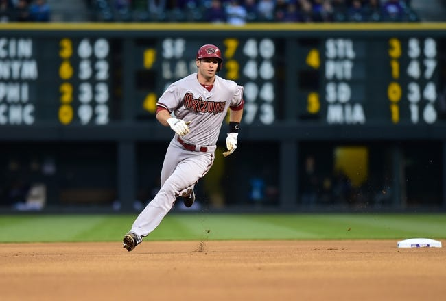 Apr 5, 2014; Denver, CO, USA; Arizona Diamondbacks first baseman Paul Goldschmidt (44) rounds second after a double by third baseman Martin Prado (14) (not pictured) against the Colorado Rockies in the first second inning at Coors Field. Mandatory Credit: Ron Chenoy-USA TODAY Sports
