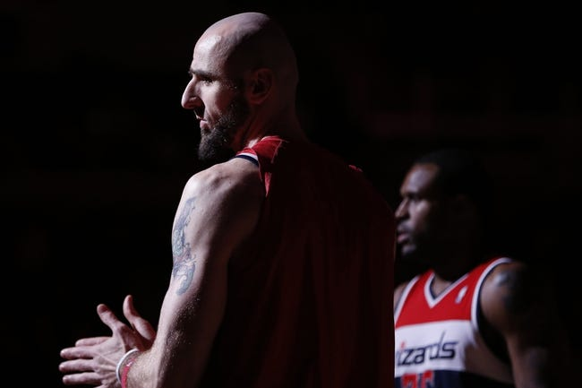 Apr 5, 2014; Washington, DC, USA; Washington Wizards center Marcin Gortat (L) and Wizards forward Trevor Booker (35) stand on the court prior to the Wizards game against the Chicago Bulls at Verizon Center. The Bulls won 96-78. Mandatory Credit: Geoff Burke-USA TODAY Sports