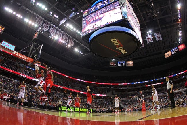 Apr 5, 2014; Washington, DC, USA; Washington Wizards forward Drew Gooden (90) shoots the ball as Chicago Bulls guard Jimmy Butler (21) defends in the second quarter at Verizon Center. The Bulls won 96-78. Mandatory Credit: Geoff Burke-USA TODAY Sports
