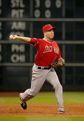 Apr 5, 2014; Houston, TX, USA; Los Angeles Angels third baseman David Freese (6) throws to first base during the third inning against the Houston Astros at Minute Maid Park. Mandatory Credit: Andrew Richardson-USA TODAY Sports