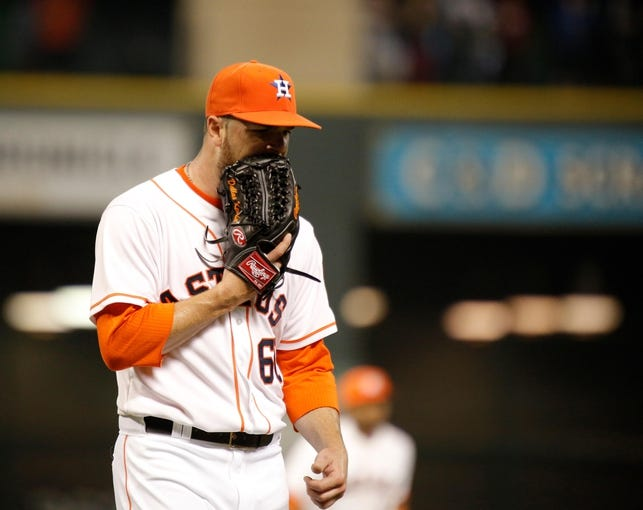 Apr 5, 2014; Houston, TX, USA; Houston Astros starting pitcher Dallas Keuchel (60) yells into his glove during the second inning against the Los Angeles Angels at Minute Maid Park. Mandatory Credit: Andrew Richardson-USA TODAY Sports