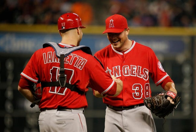 Apr 5, 2014; Houston, TX, USA; Los Angeles Angels relief pitcher Joe Smith (38) high-fives catcher Chris Iannetta (17) after striking out the final batter during the ninth inning against the Houston Astros at Minute Maid Park. Mandatory Credit: Andrew Richardson-USA TODAY Sports