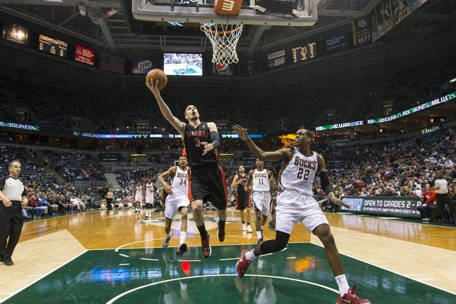 Apr 5, 2014; Milwaukee, WI, USA; Toronto Raptors guard Nando de Colo (3) shoots the ball during the third quarter against the Milwaukee Bucks at BMO Harris Bradley Center. Mandatory Credit: Jeff Hanisch-USA TODAY Sports
