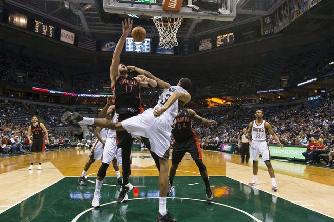 Apr 5, 2014; Milwaukee, WI, USA; Milwaukee Bucks center John Henson (31) blocks the shot by Toronto Raptors center Jonas Valanciunas (17) during the third quarter at BMO Harris Bradley Center. Mandatory Credit: Jeff Hanisch-USA TODAY Sports