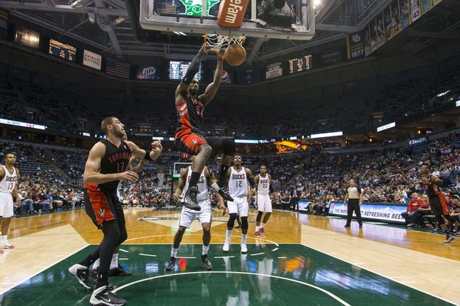 Apr 5, 2014; Milwaukee, WI, USA; Toronto Raptors forward Patrick Patterson (54) dunks the ball during the third quarter against the Milwaukee Bucks at BMO Harris Bradley Center. Mandatory Credit: Jeff Hanisch-USA TODAY Sports