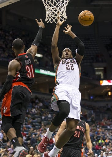 Apr 5, 2014; Milwaukee, WI, USA; Toronto Raptors forward Terrence Ross (31) knocks the ball away from Milwaukee Bucks forward Khris Middleton (22) during the third quarter at BMO Harris Bradley Center. Mandatory Credit: Jeff Hanisch-USA TODAY Sports