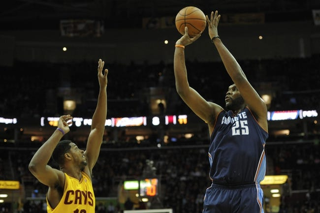 Apr 5, 2014; Cleveland, OH, USA; Charlotte Bobcats center Al Jefferson (25) shoots the ball over Cleveland Cavaliers forward Tristan Thompson (13) in the first quarter at Quicken Loans Arena. Mandatory Credit: David Richard-USA TODAY Sports
