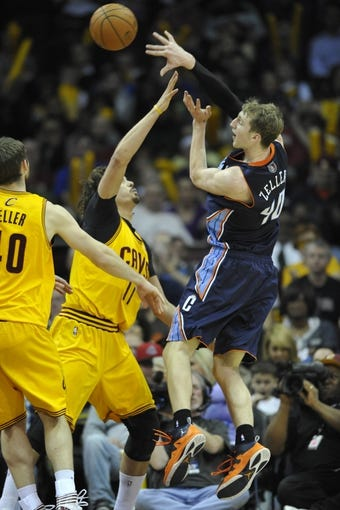 Apr 5, 2014; Cleveland, OH, USA; Charlotte Bobcats center Cody Zeller (40) passes the ball over Cleveland Cavaliers center Anderson Varejao (17) in the third quarter at Quicken Loans Arena. Mandatory Credit: David Richard-USA TODAY Sports