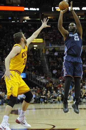 Apr 5, 2014; Cleveland, OH, USA; Charlotte Bobcats center Al Jefferson (25) shoots the ball over Cleveland Cavaliers center Spencer Hawes (32) in the first quarter at Quicken Loans Arena. Mandatory Credit: David Richard-USA TODAY Sports