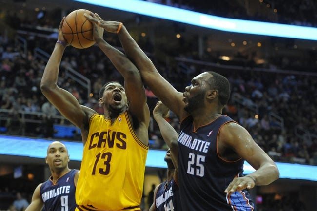 Apr 5, 2014; Cleveland, OH, USA; Charlotte Bobcats center Al Jefferson (25) blocks the shot by Cleveland Cavaliers forward Tristan Thompson (13) in the third quarter at Quicken Loans Arena. Mandatory Credit: David Richard-USA TODAY Sports