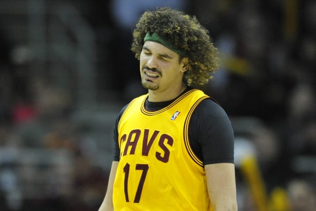 Apr 5, 2014; Cleveland, OH, USA; Cleveland Cavaliers center Anderson Varejao (17) reacts in overtime against the Charlotte Bobcats at Quicken Loans Arena. Mandatory Credit: David Richard-USA TODAY Sports