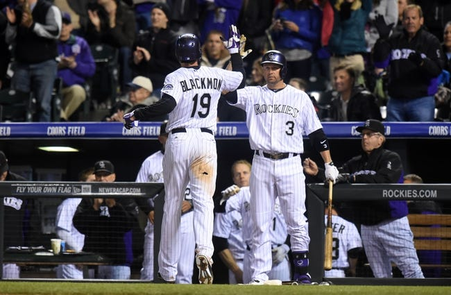 Apr 5, 2014; Denver, CO, USA; Colorado Rockies right fielder Charlie Blackmon (19) is congratulated by right fielder Michael Cuddyer (3) after scoring in the fifth inning against the Arizona Diamondbacks at Coors Field. The Rockies defeated the Diamondbacks 9-4. Mandatory Credit: Ron Chenoy-USA TODAY Sports