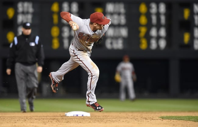 Apr 5, 2014; Denver, CO, USA; Arizona Diamondbacks shortstop Chris Owings (16) prepares to throw to first base during the fifth inning against the Colorado Rockies at Coors Field. The Rockies defeated the Diamondbacks 9-4. Mandatory Credit: Ron Chenoy-USA TODAY Sports