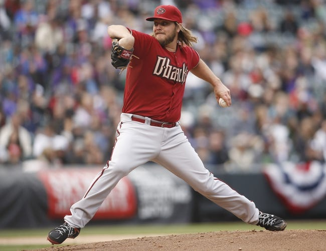 Apr 6, 2014; Denver, CO, USA; Arizona Diamondbacks starting pitcher Wade Miley (36) delivers a pitch during the second inning against the Colorado Rockies at Coors Field. Mandatory Credit: Chris Humphreys-USA TODAY Sports