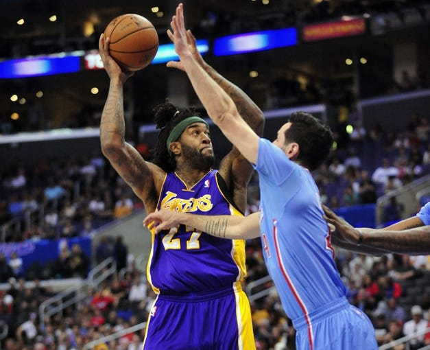 April 6, 2014; Los Angeles, CA, USA; Los Angeles Lakers  forward Jordan Hill (27) shoots against the Los Angeles Clippers during the first half at Staples Center. Mandatory Credit: Gary A. Vasquez-USA TODAY Sports