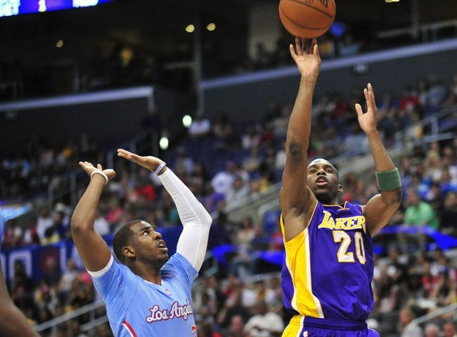 April 6, 2014; Los Angeles, CA, USA; Los Angeles Lakers guard Jodie Meeks (20) attempts a shot against the Los Angeles Clippers during the first half at Staples Center. Mandatory Credit: Gary A. Vasquez-USA TODAY Sports