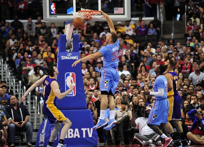 April 6, 2014; Los Angeles, CA, USA; Los Angeles Clippers forward Blake Griffin (32) dunks to score a basket against the Los Angeles Lakers during the first half at Staples Center. Mandatory Credit: Gary A. Vasquez-USA TODAY Sports