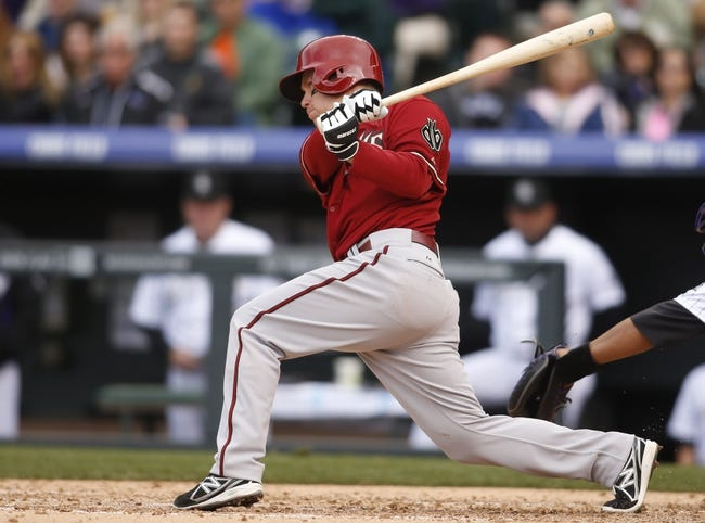 Apr 6, 2014; Denver, CO, USA; Arizona Diamondbacks second baseman Aaron Hill (2) hits a double during the sixth inning against the Colorado Rockies at Coors Field. Mandatory Credit: Chris Humphreys-USA TODAY Sports