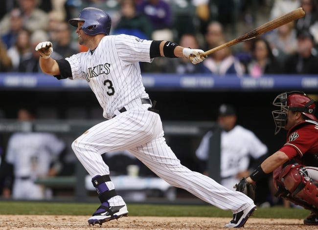 Apr 6, 2014; Denver, CO, USA; Colorado Rockies first baseman Michael Cuddyer (3) hits a single during the sixth inning against the Arizona Diamondbacks at Coors Field. Mandatory Credit: Chris Humphreys-USA TODAY Sports