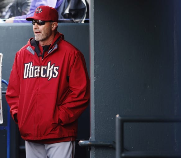 Apr 6, 2014; Denver, CO, USA; Arizona Diamondbacks manager Kirk Gibson during the fourth inning against the Colorado Rockies at Coors Field. Mandatory Credit: Chris Humphreys-USA TODAY Sports
