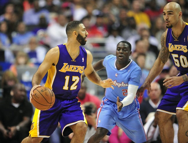 April 6, 2014; Los Angeles, CA, USA; Los Angeles Lakers guard Kendall Marshall (12) controls the ball against the Los Angeles Clippers during the second half at Staples Center. Mandatory Credit: Gary A. Vasquez-USA TODAY Sports