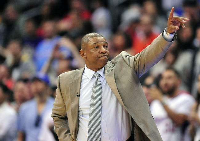 April 6, 2014; Los Angeles, CA, USA; Los Angeles Clippers Doc Rivers watches game action against the Los Angeles Lakers during the second half at Staples Center. Mandatory Credit: Gary A. Vasquez-USA TODAY Sports