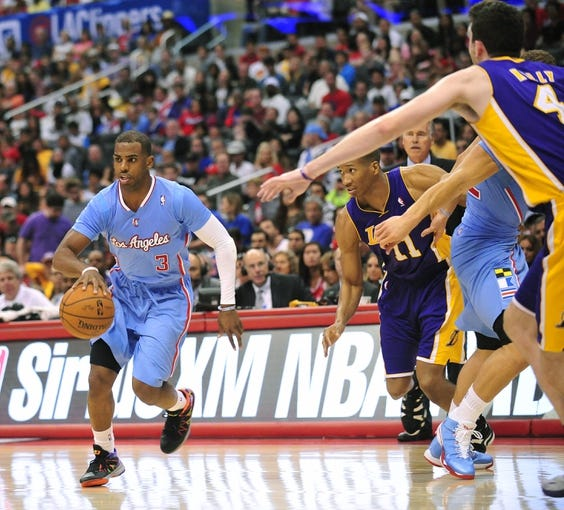 April 6, 2014; Los Angeles, CA, USA; Los Angeles Clippers guard Chris Paul (3) moves the ball against the Los Angeles Lakers during the second half at Staples Center. Mandatory Credit: Gary A. Vasquez-USA TODAY Sports