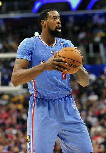 April 6, 2014; Los Angeles, CA, USA; Los Angeles Clippers center DeAndre Jordan (6) controls the ball against the Los Angeles Lakers during the second half at Staples Center. Mandatory Credit: Gary A. Vasquez-USA TODAY Sports