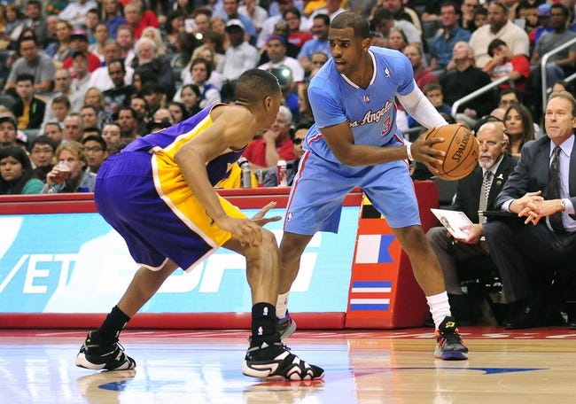 April 6, 2014; Los Angeles, CA, USA; Los Angeles Clippers guard Chris Paul (3) controls the ball against Los Angeles Lakers forward Wesley Johnson (11) during the second half at Staples Center. Mandatory Credit: Gary A. Vasquez-USA TODAY Sports