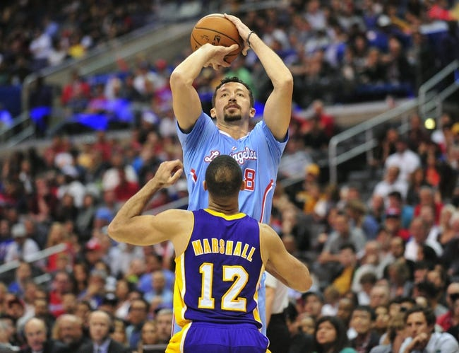 April 6, 2014; Los Angeles, CA, USA; Los Angeles Clippers forward Hedo Turkoglu (8) attempts a shot against Los Angeles Lakers guard Kendall Marshall (12) during the second half at Staples Center. Mandatory Credit: Gary A. Vasquez-USA TODAY Sports
