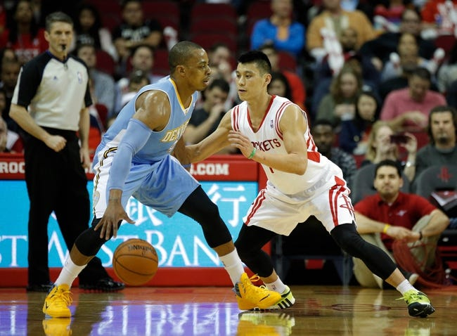 Apr 6, 2014; Houston, TX, USA; Denver Nuggets guard Randy Foye (4) is defended by Houston Rockets guard Jeremy Lin (7) during the first quarter at Toyota Center. Mandatory Credit: Andrew Richardson-USA TODAY Sports