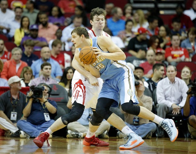 Apr 6, 2014; Houston, TX, USA; Denver Nuggets center Timofey Mozgov (25) is defended by Houston Rockets center Omer Asik (3) during the first quarter at Toyota Center. Mandatory Credit: Andrew Richardson-USA TODAY Sports