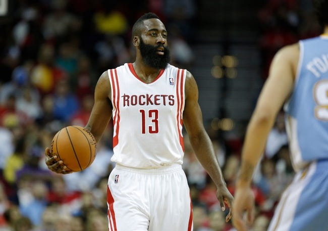 Apr 6, 2014; Houston, TX, USA; Houston Rockets guard James Harden (13) brings up the ball during the first quarter against the Denver Nuggets at Toyota Center. Mandatory Credit: Andrew Richardson-USA TODAY Sports