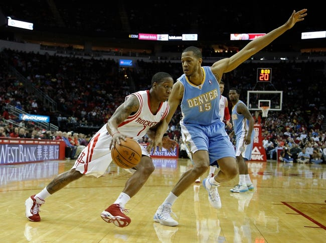 Apr 6, 2014; Houston, TX, USA; Houston Rockets guard Isaiah Canaan (1) drives to the basket past Denver Nuggets forward Anthony Randolph (15) during the second quarter at Toyota Center. Mandatory Credit: Andrew Richardson-USA TODAY Sports
