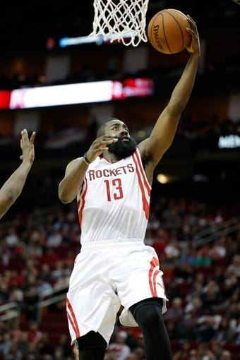 Apr 6, 2014; Houston, TX, USA; Houston Rockets guard James Harden (13) shoots the ball during the second quarter against the Denver Nuggets at Toyota Center. Mandatory Credit: Andrew Richardson-USA TODAY Sports