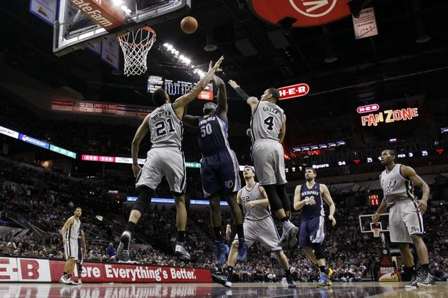 Apr 6, 2014; San Antonio, TX, USA; Memphis Grizzlies forward Zach Randolph (50) shoots the ball over San Antonio Spurs forward Tim Duncan (21) during the second half at AT&T Center. The Spurs won 112-92. Mandatory Credit: Soobum Im-USA TODAY Sports