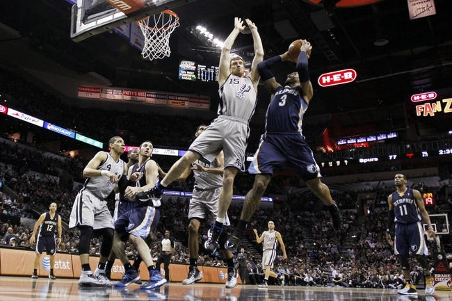 Apr 6, 2014; San Antonio, TX, USA; Memphis Grizzlies forward James Johnson (3) shoots the ball as San Antonio Spurs forward Matt Bonner (15) defends during the second half at AT&T Center. The Spurs won 112-92. Mandatory Credit: Soobum Im-USA TODAY Sports